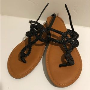 Black braided flat sandals